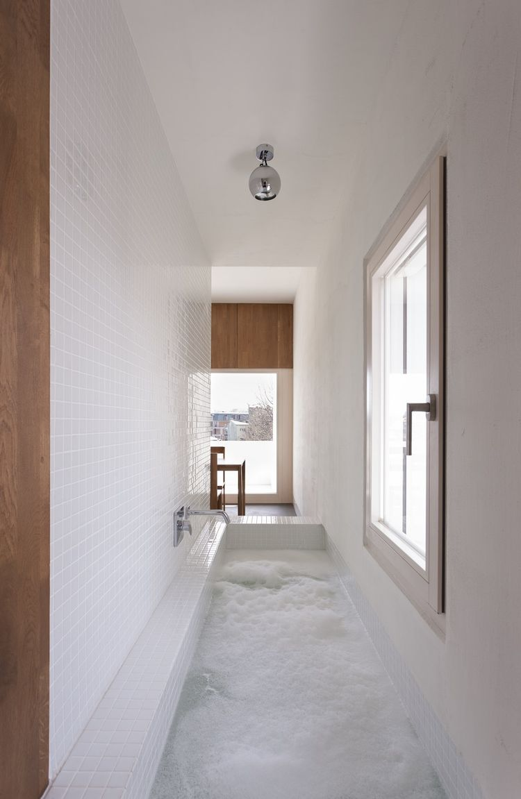 Tackling narrow bathroom layouts livinghouse blog for Narrow baths for small bathrooms