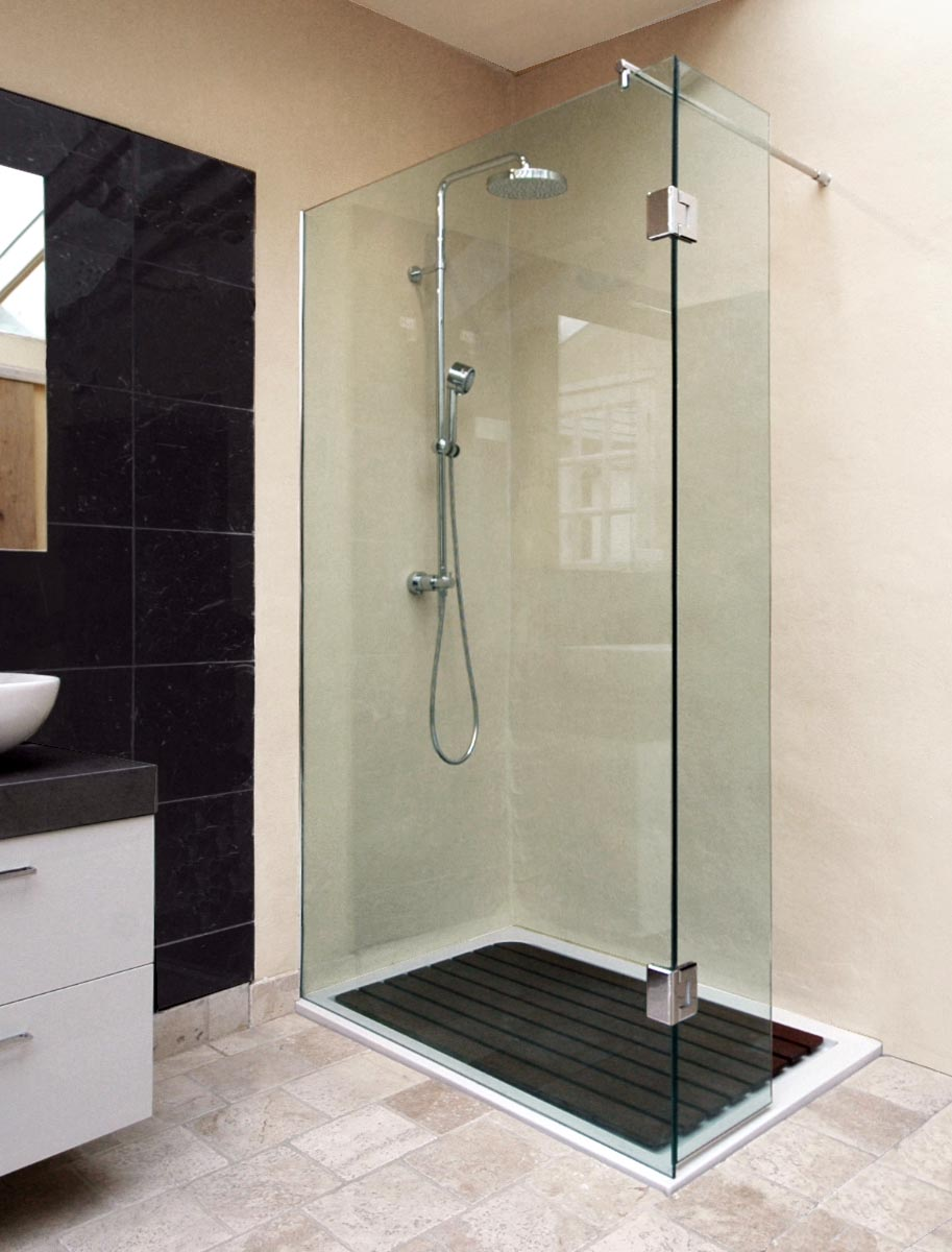 shower enclosure with hinged deflector
